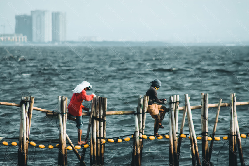 Two men working on a bridge in the Philippines