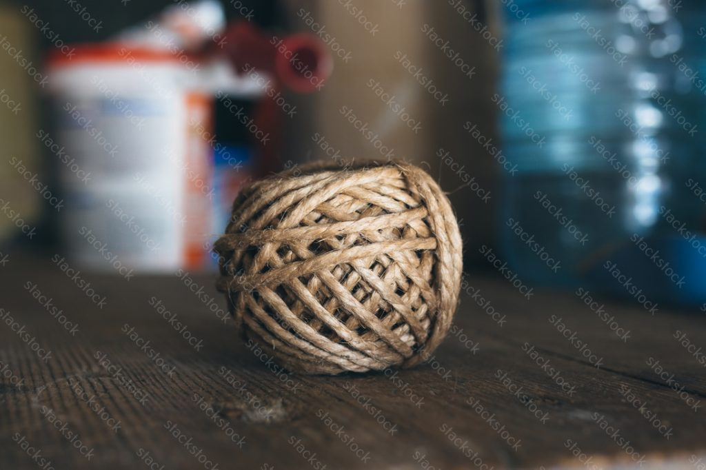 Brown ball of yarn on a wooden table