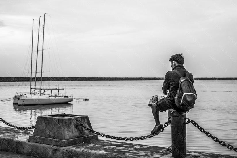 Man sitting at the dock