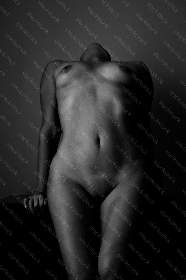 Portrait of naked woman with beautiful body. Black and white