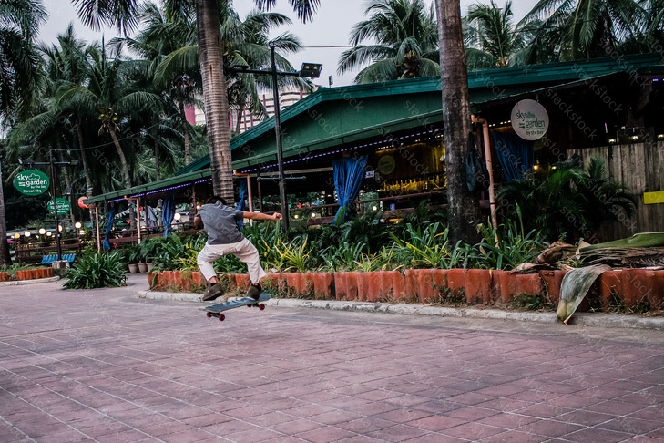 Young Filipino boy skateboarding