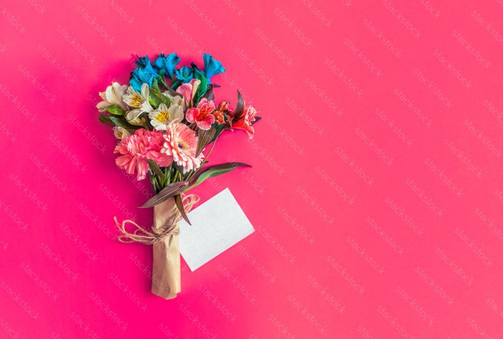 Flowers with copy space on pink background