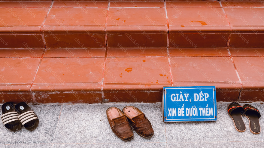 Shoes on the steps at a temple