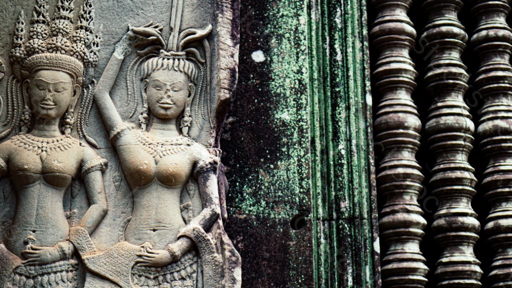 Stone carving of female priest, Angkor Wat temple.  Siem Reap, Cambodia.