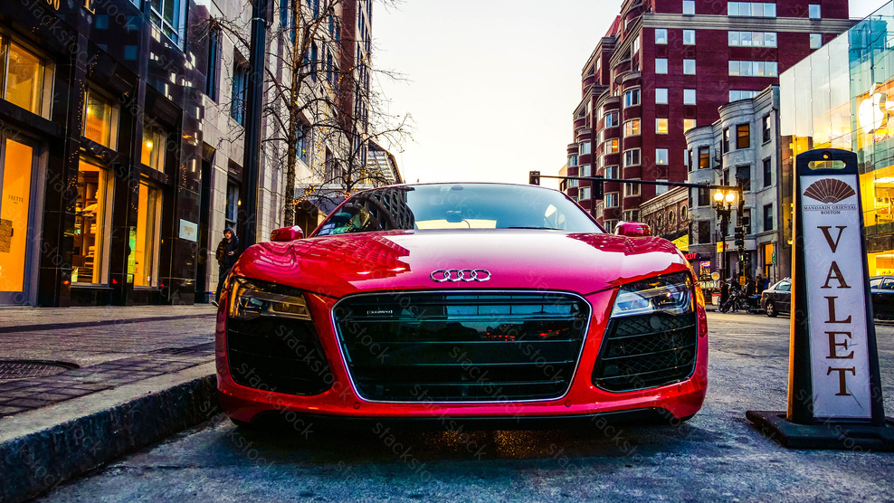 Red Audi R8 parked in Valet
