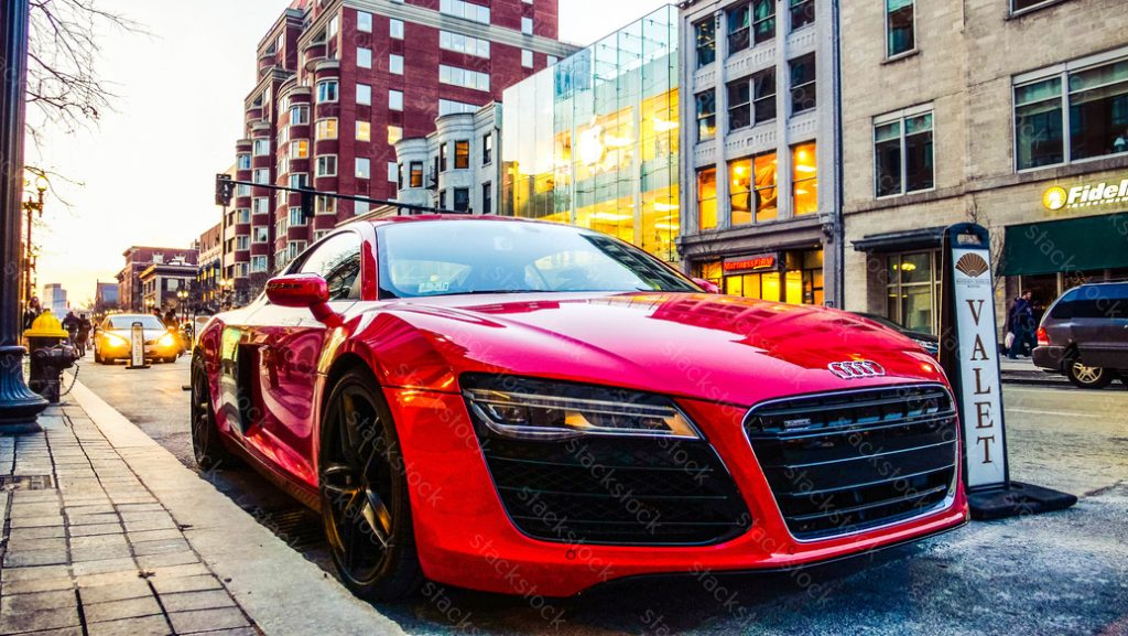 Red Audi R8 parked in Valet. Side view