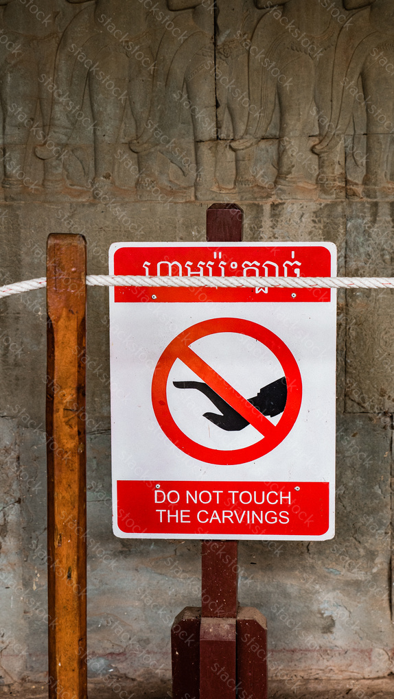 Do not touch the carvings sign – Notice at Angkor Wat. Cambodia