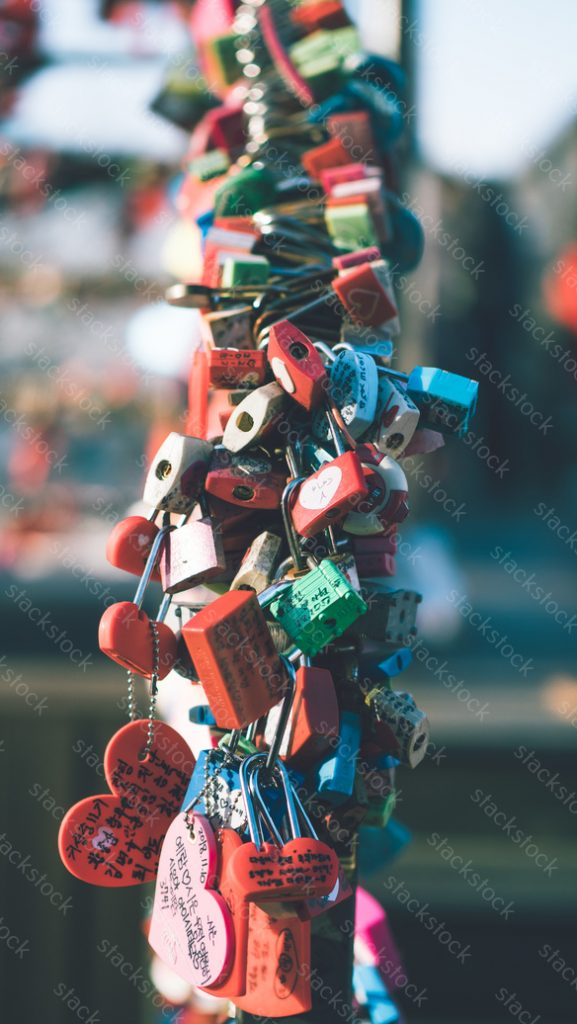 Padlock which lock to the gate and fence to symbolize love, N Seoul Tower, Korea