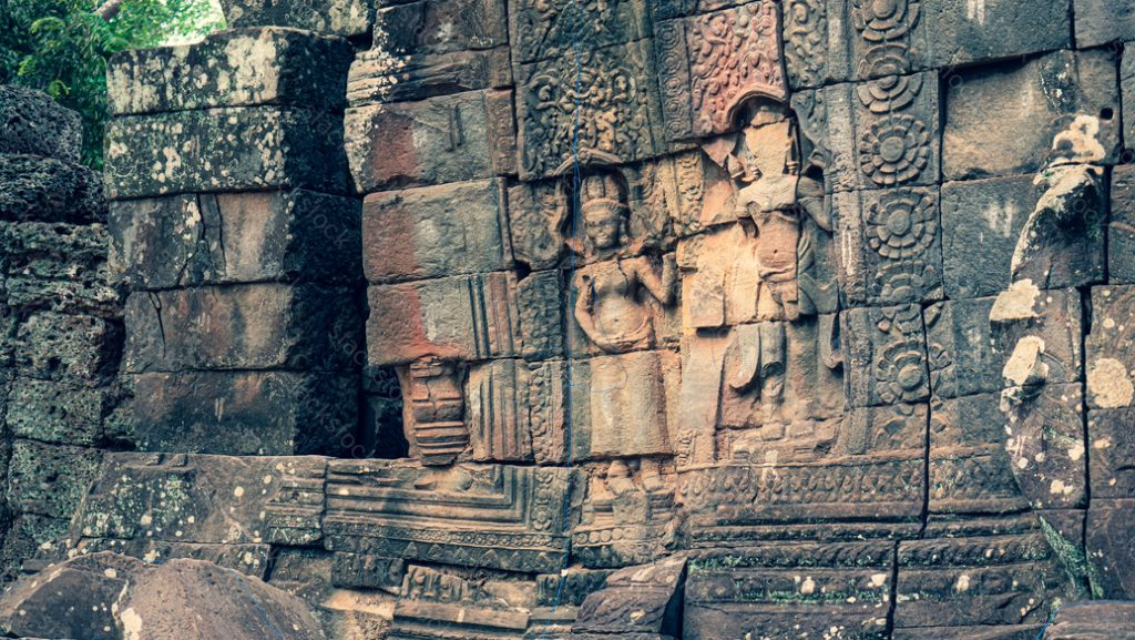 Wall of ancient Apsara statue at Ta Prohm Temple. Cambodia
