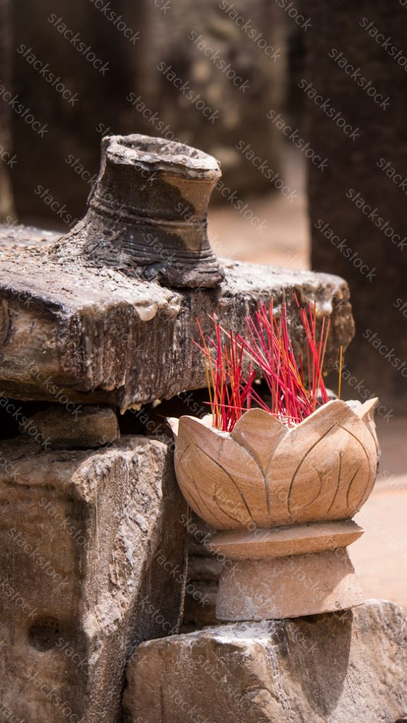 Incense sticks in a bowl at a temple in Cambodia