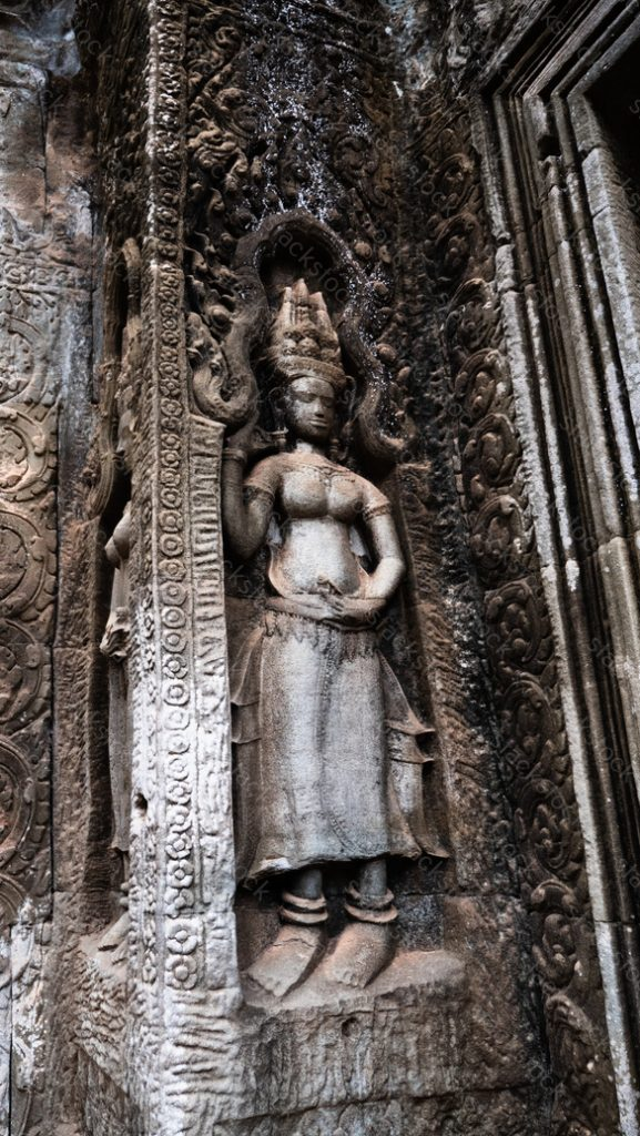 Apsara, stone carvings on the wall of Angkor Ta Prohm. Cambodia