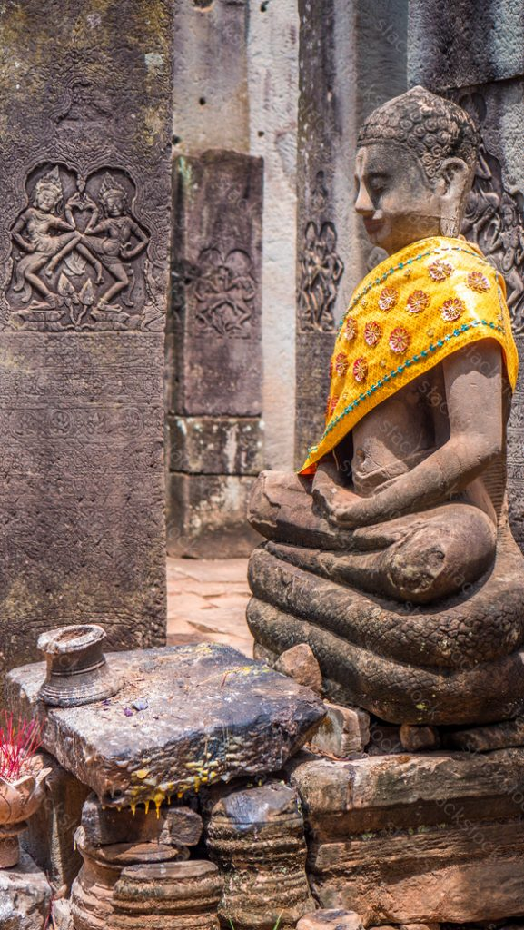 Buddha statue at Bayon temple in Angkor in Cambodia