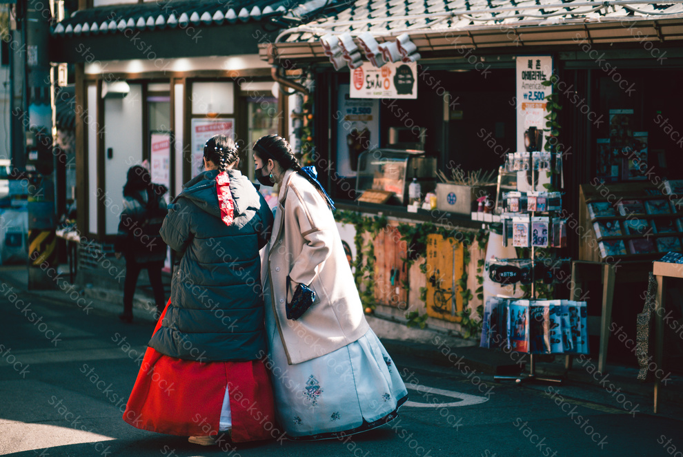 Korean girls dressed in traditional dress hanbok at Bukchon Hanok Village, Seoul, South Korea.