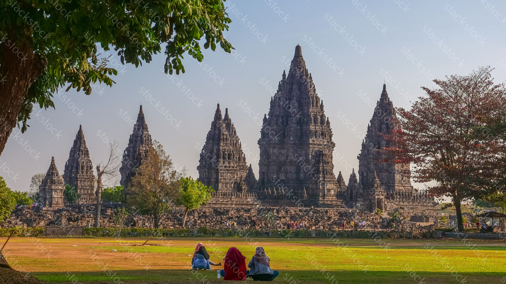 Tourist sitting at Prambanan Temple. Indonesia